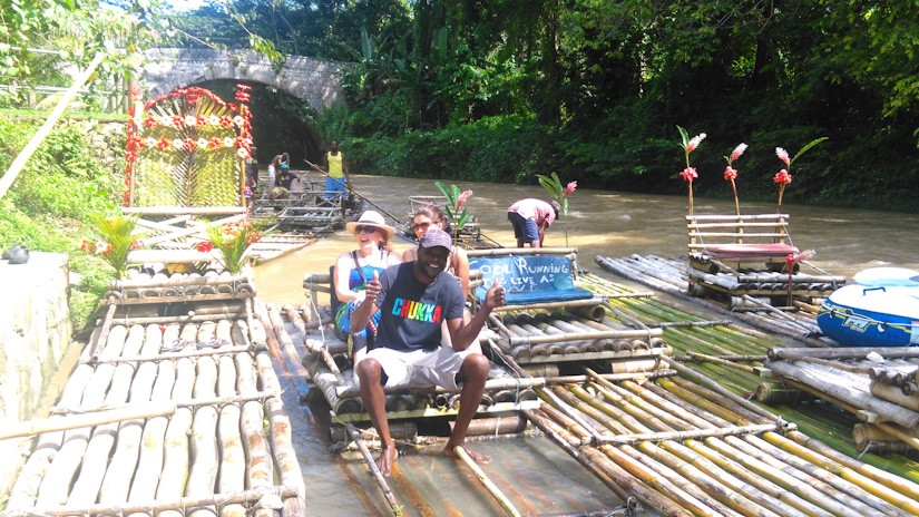 Noreen and Emma ready to push off on Captain Noel's Bamboo raft on the Great River in Jamaica