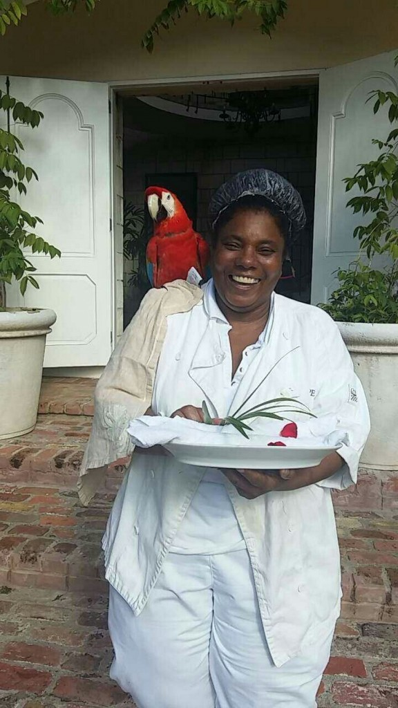 Peaches the chef at Villa Bambu and her pet parrot Eva
