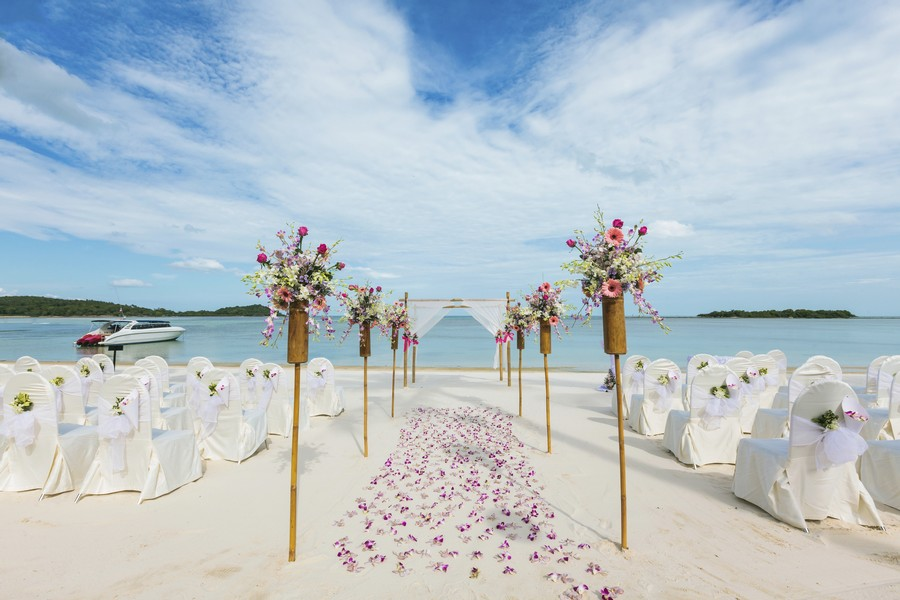 Rose petals sprinkled lightly across the sand at a beach Wedding in Barbados