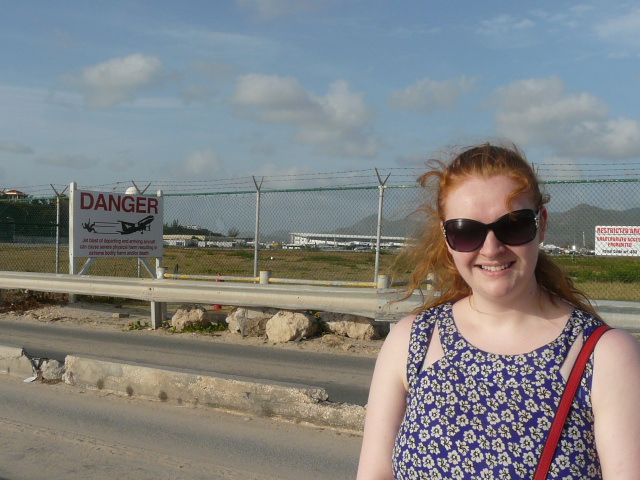 Niamh McCarthy, our St Martin Villas expert, waits patiently for the Jumbo Jet to roar overhead at Maho beach in St Martin