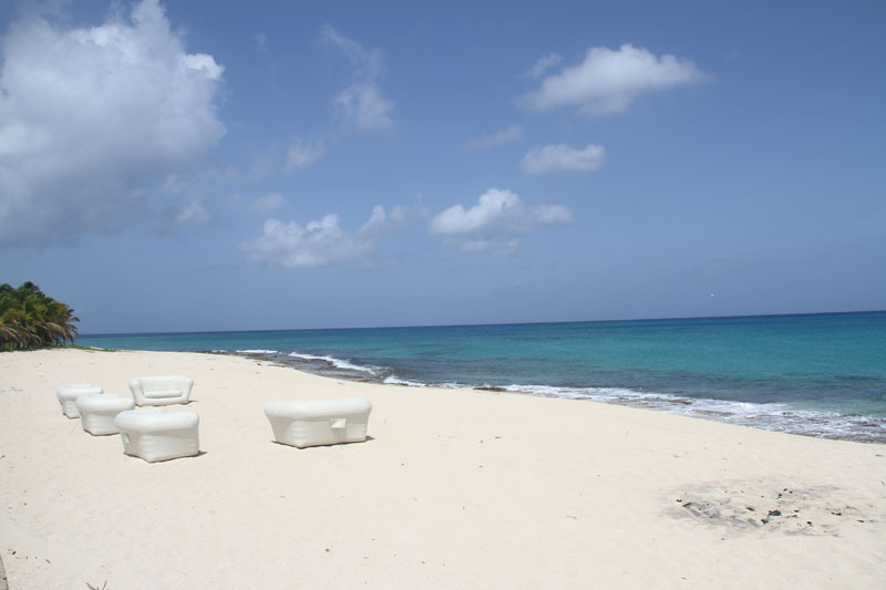 Massively comfortable white sofas on the beach go nicely with the powdery white sand at Plum Bay Beach