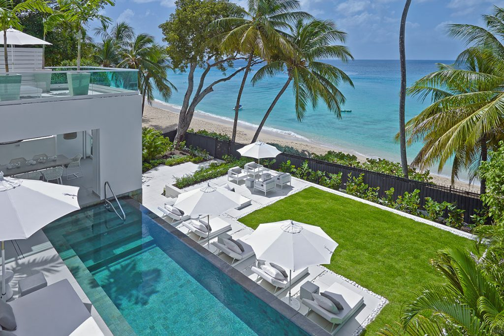 The View of the pool and then the beach from the second floor of Footprints. The villa has clean cut white edges and glitters prettily in the Caribbean sun.