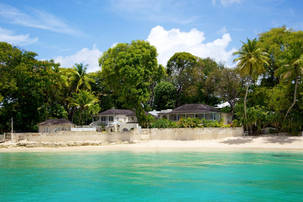 Landfall villa sitting right on the white sandy beach