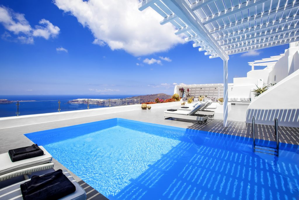 The sun deck at Erossea Villa in Santorini. Lots of blue. Lots of white. Lots of cool.