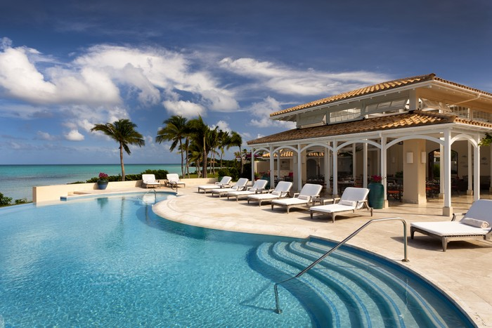 Sun Loungers by the Pool at Jumby Bay