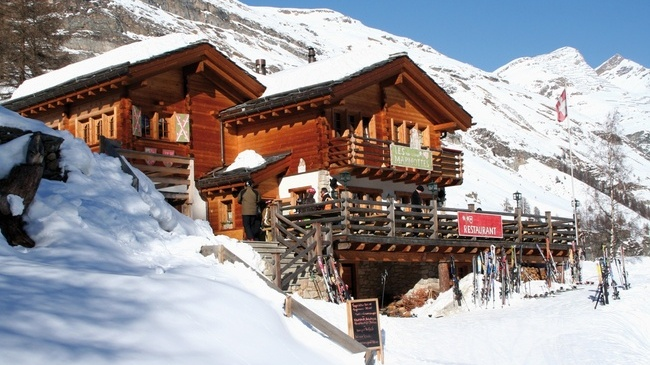 Les Marmottes restaurant sits comfortably in the Alpine snow