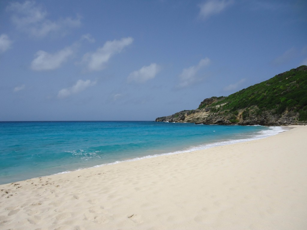 Gouveneur Beach with white powdery sand and a vast blue horizon