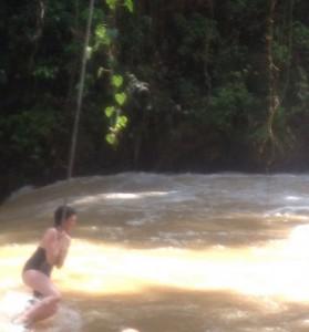 Emma heroically swings across the rapids