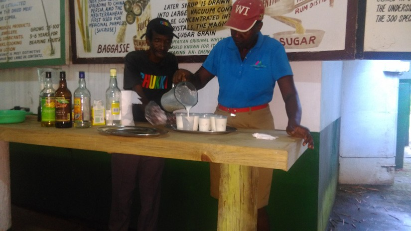Mr Dalton of Chukka Adventures prepares Pina Coladas for Emma and Noreen