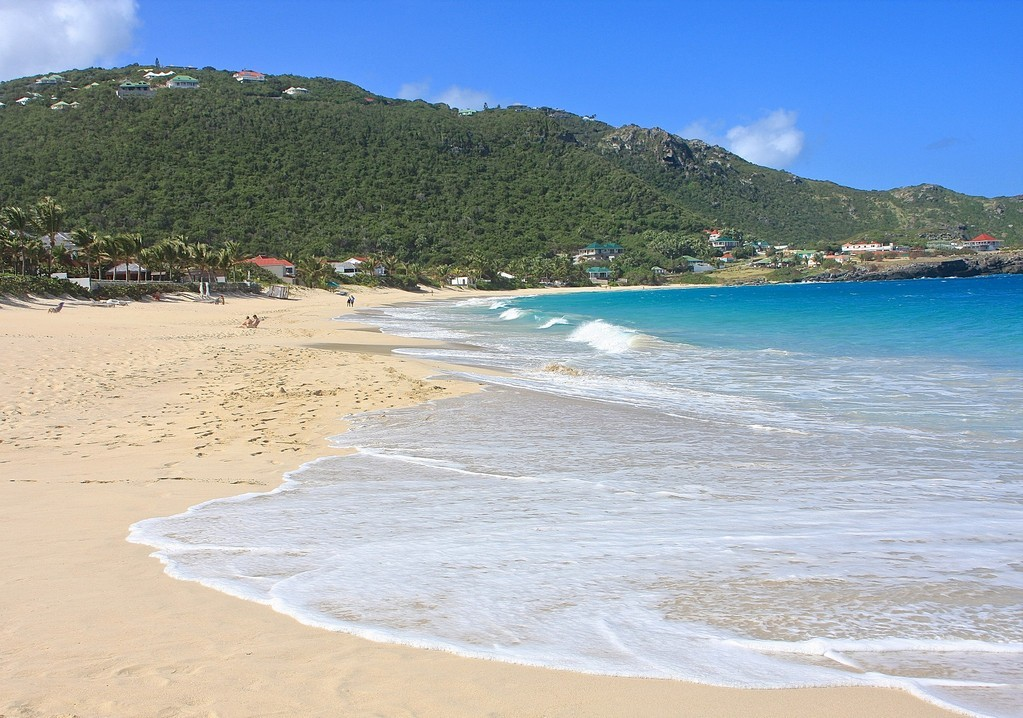 Waves gently ebbing up the golden sandy Flamands Beach in St Barts