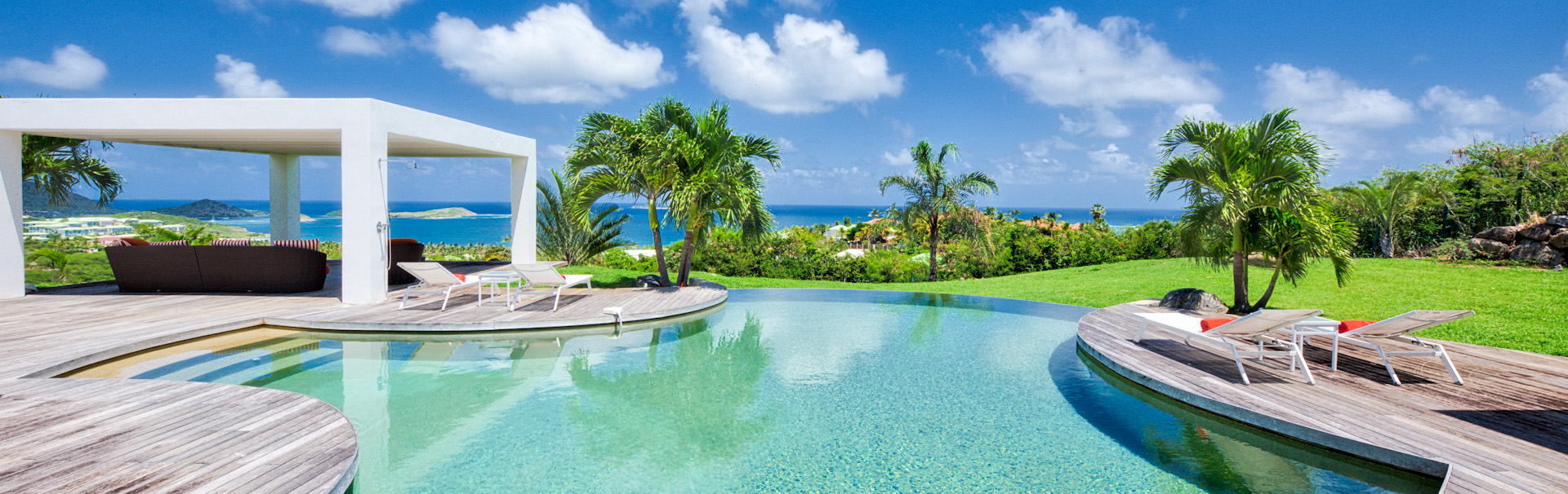 Pool, shade, and sundeck at a beach front villa in St Martin