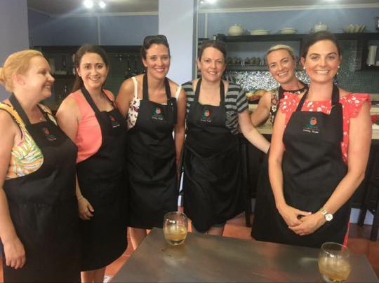 A fresh group prepare for instruction at the Spice Cooking Studio in St Lucia