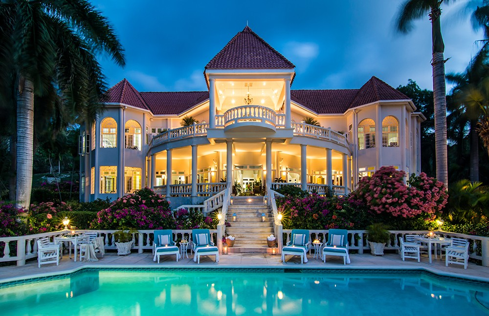 Looking more like a palace than a Jamaican villa, Endless summer stands proud over the wide blue pool.