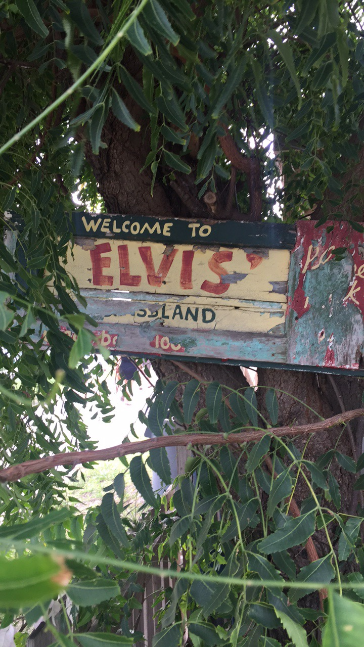 The sign for Elvis beach bar on sandy fround Anguilla