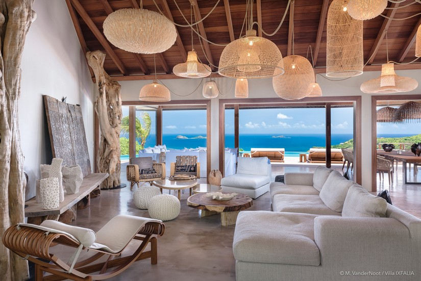 Pastel toned living area with sea horizons at Ixfalia