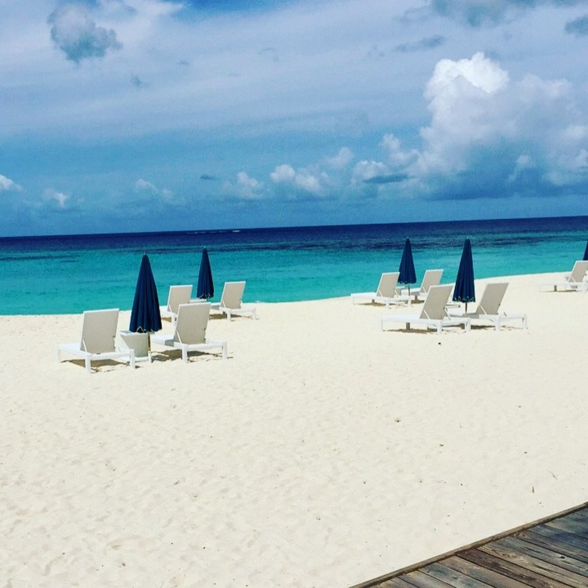a gorgeous view of Shoal Bay east with white sand and turquoise blue sea