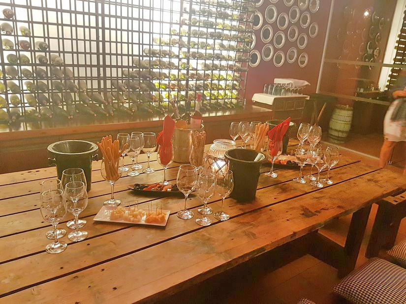 A rustic table with wine and nibbles at Eagles Palace in Halkidiki