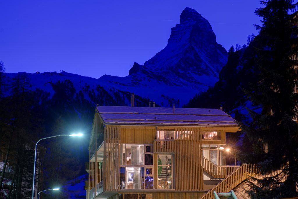 Backstage Loft set against the purple-blue of dusk in Zermatt