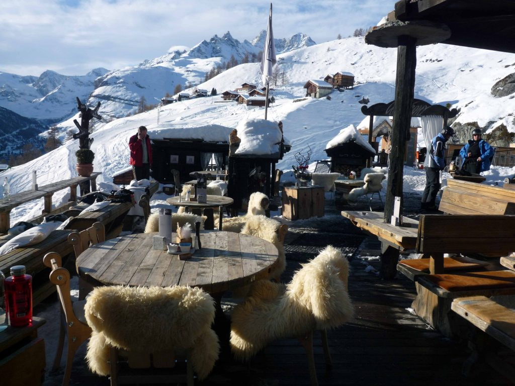 Chez Vrony's outdoor dining area, complete with fur-lined chairs