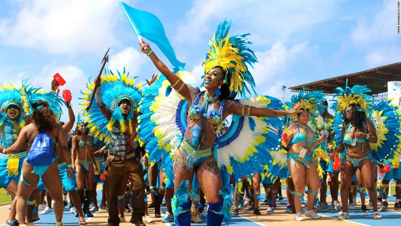 Massive head-dresses and brightly coloured feathers abound at the Crop over festival in Barbados