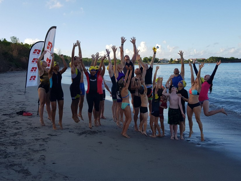 A big pile of triathletes psyche themselves up for the swim
