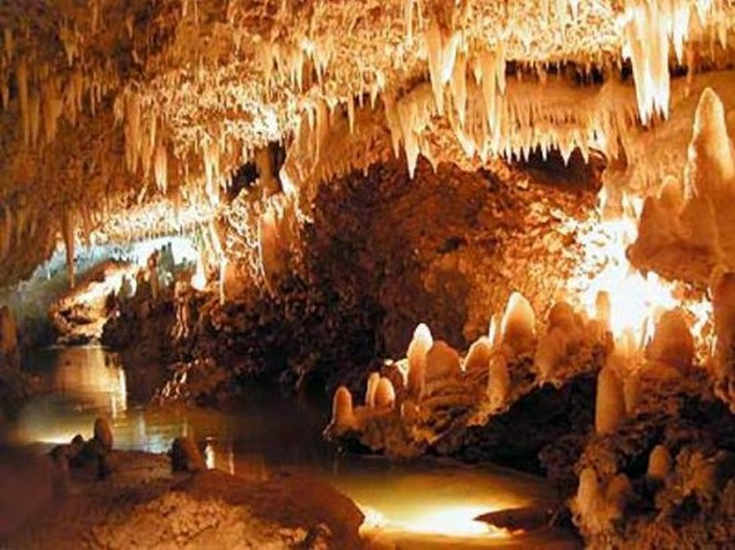 A beautiful array of stalactites and stalagmites illuminated in Harrison's Cave in Barbados
