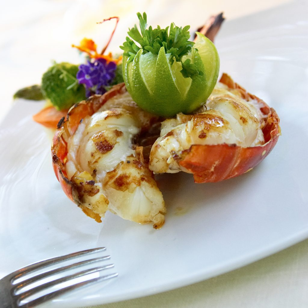 Fresh, succulent lobster served with a lime garnish - one of the many fine dining treats delivered by the restaurants in Turks and Caicos