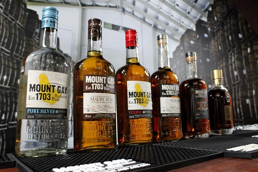 Five varieties of Mount Gay rum lined up on a bar
