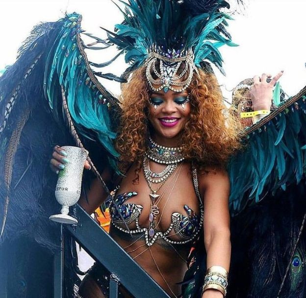 Rihanna dressed Caribbean carnival style with a massive pair of blue feathery wings