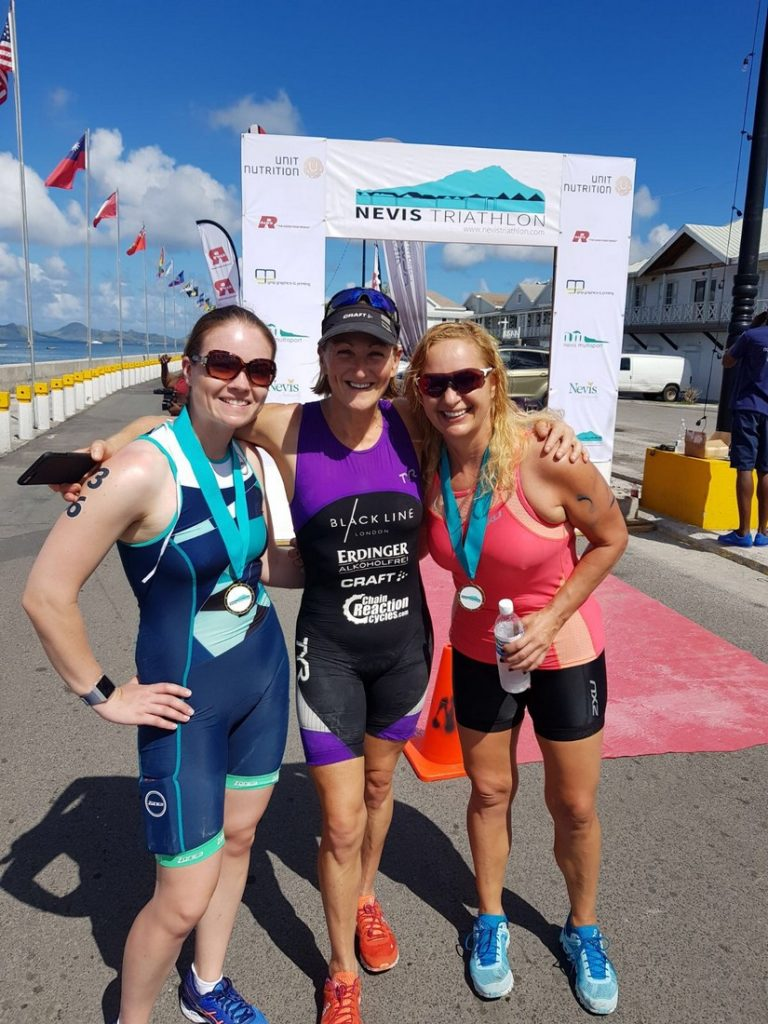 The first three of the 2017 Nevis triathlon pose at the finish line