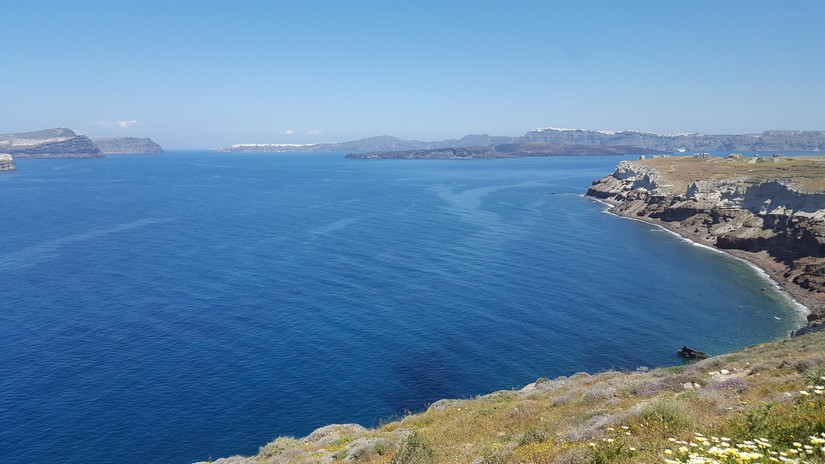 The view of the sea encompassed by a volcanic caldera as seen from the lighthouse at akrotiri in santorini, Greece