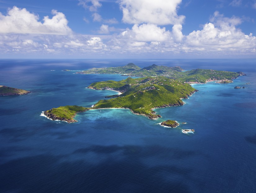 St Barts as seen from the air - very green and hilly set in a deep blue sea. From the Exceptional Villas Ultimate St Barts Travel Guide