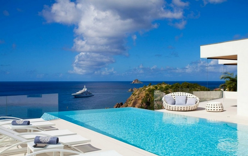 View of a cruise ship across the infinity pool at villa vitti
