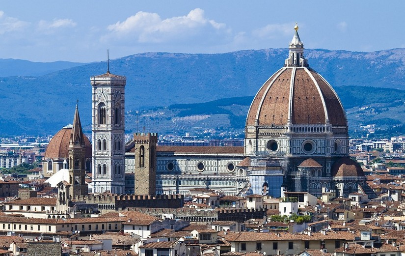 View of the rooftops of Florence with a large domed cathedral in the middle