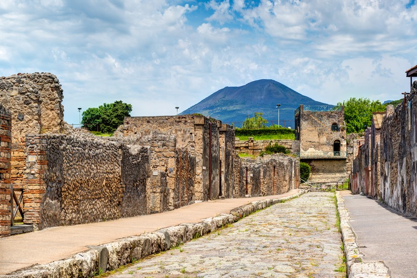 A desrted street in Pompeii with Vesuvius in the background