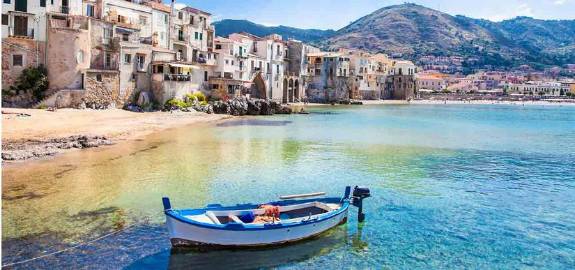 A small boat moored at a shore on Sicily