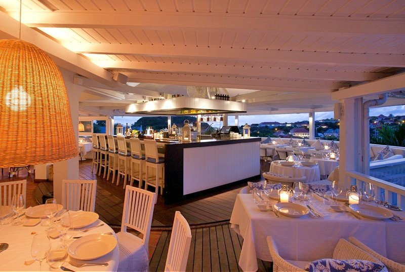 Most St Barthelemy are top notch and Bonito is no exception. Tables classically dressed in white with wicker chairs surround a central bar area. The dining area has a panoramic view of Gustavia and all of it's pleasing architecture.