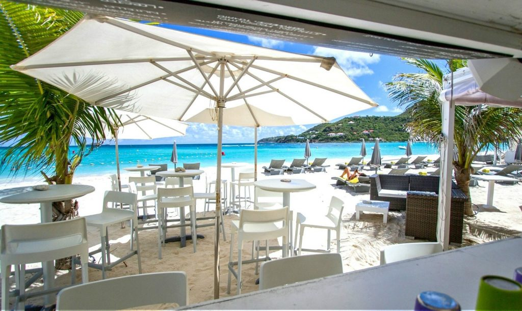 Parasols and palm trees provide cooling shade for diners at this restaurant on the beach. Not far from the dining area the Caribbean Seas glitters in the sunlight in exactly the same way that coal doesn't. Considered to be one of the best places to in eat in St Barts La Plage is a very popular spot for visitors and locals alike.