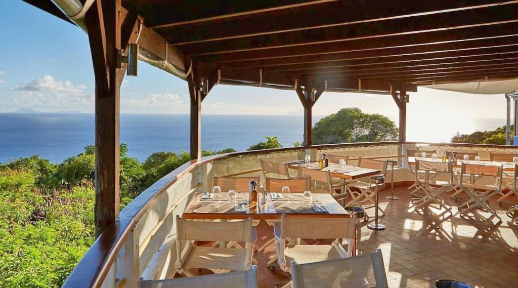The dining are at Santa Fe is a curved balcony that has a frankly epic view of the vast blue horizon over a fringe of thick green forest. The floor is paved with smooth terracotta tiles and the restaurant is shaded by a ceiling with rich, dark open joists. It's lovely.