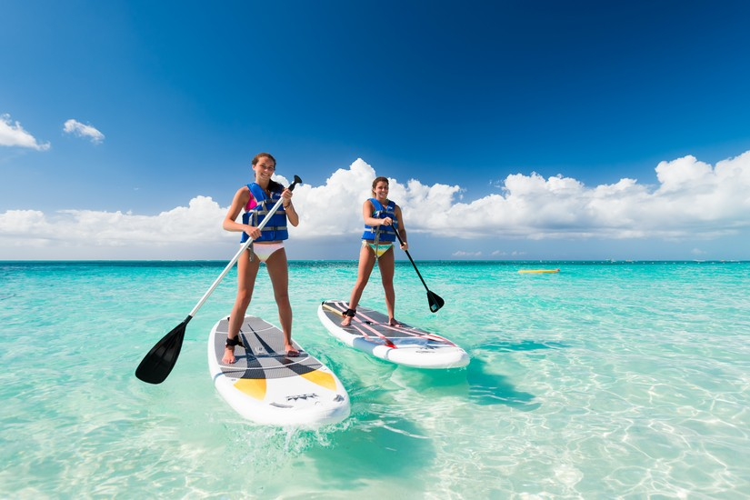 One of the best things to do in Turks and Caicos is to sort out activities for your kids, such as paddle boarding, so that you can sit on the beach and drink beer. Or cocktails.