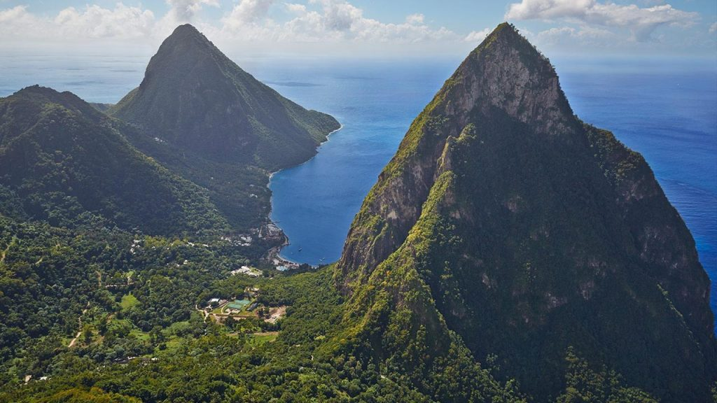 The Pitons loom out of the earth like two beautiful, green covered vampire fangs.