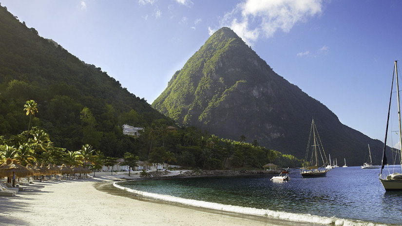One of the Pitons looms both massively and majestically from the sea in exactly the same way that puppies don't.