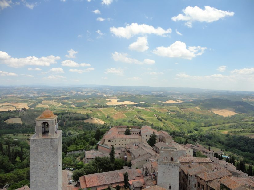 Elevated view of the shambling grey towers of San Gimignano
