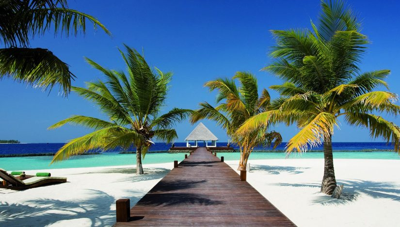 If you want to rent a private island then Coco Prive is the island for you. This picture shows a long promenade terminated by a gazebo that provides a nice spot to shelter from the crazy hot sun