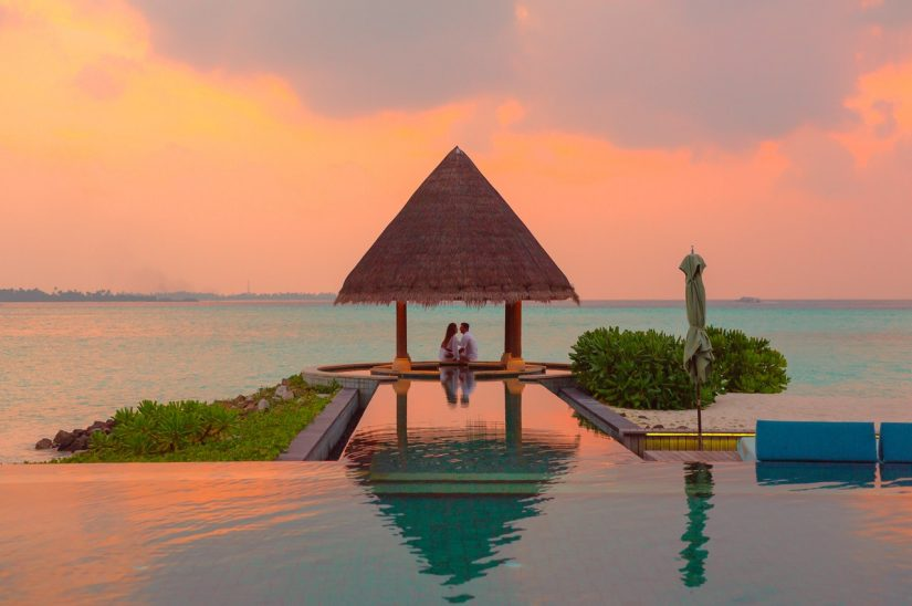 Romantic setting for a couple on honeymoon watching the sun set over St Martin