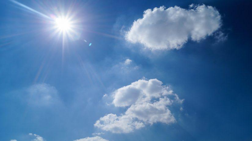 Wonderful blue sky, light fluffy clouds and brilliant sunshine