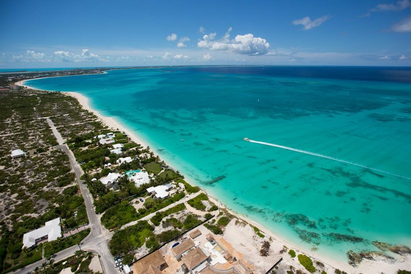 Ariel shot of Grace Bay in Turks and Caicos - Vast Turquoise waters and Sandy shores