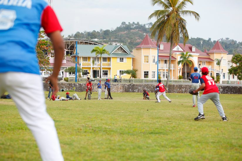 Kids playing baseball in a field in the dominican republic