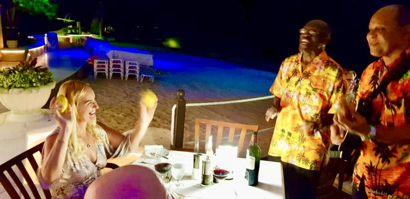 Alex waves lemons at two unsuspecting musicians at the Bajan Blue restaurant in Barbados