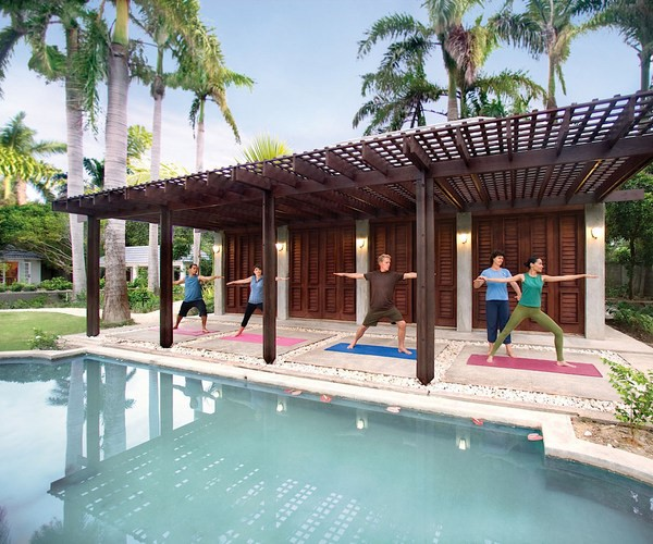 Breathe in this Caribbean way of life with some relaxing half moon yoga